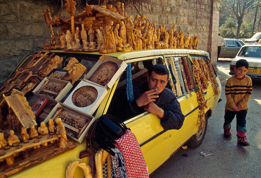 A merchant of Christian souvenirs on the streets of Jerusalem.