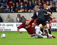 Photo: Dave Linney.<br />Walsall v Milton Keynes Dons. Coca Cola League 2. 28/10/2006.Walsall's Hector Sam(L) goes to ground after a challenge by  Sean O'Hanlon