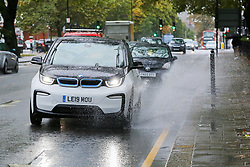 © Licensed to London News Pictures. 04/10/2020. London, UK. A can drives through surface rainwater in north London, as Storm Alex brings heavy rain to large parts of the UK. The Met Office forecasts heavy rain and windy weather for the next of the day in the capital. Photo credit: Dinendra Haria/LNP