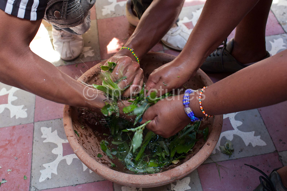 This herbal mixture will be used to cleanse the heads of those being initiated. The mixture is prepared by hand for a long time, the idea being that it will encase the positive, cleansing energy from those preparing it. Santeria is a syncretic religion practiced in Cuba, it is a mixture of Yoruba tribal practices brought from Nigeria during Colonial times, and traditional Catholic beliefs. During this time, the slaves used the images of saints to cover up their worship of the Orishas (spirits).