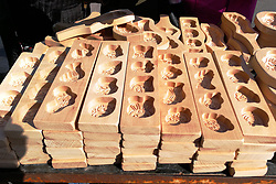 February 6, 2018 - Qingdao, Qingdao, China - Qingdao,CHINA-6th February 2018: The wooden moulds of steamed bun making are on sale in Qingdao, east China's Shandong Province. It's a tradition to make steamed buns of different shapes during Spring Festival in China. (Credit Image: © SIPA Asia via ZUMA Wire)