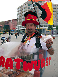 Man selling traditional bratwurst sausages in Berlin Germany