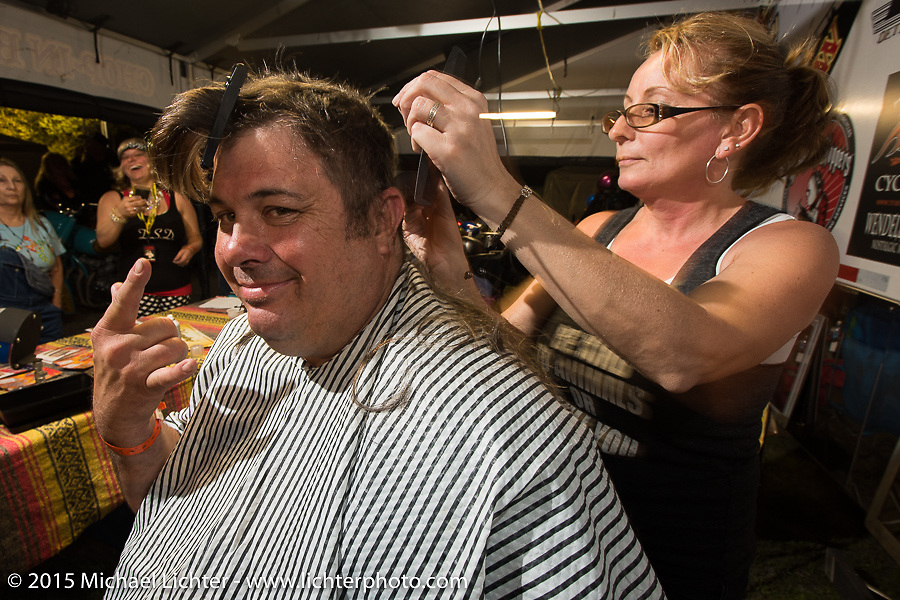 """""""Fajita Mike"""" of Trimble, TN and the Full Throttle Saloon reality TV show gets his hair shaved off at the Cackleberry Campground in the Chop-In Blocks """"Biker Beard-Off"""" to benefit the Aidan Jack Seeger foundation for ALD during Daytona Beach Bike Week, FL, USA. Thursday, March 12, 2015.  Photography ©2015 Michael Lichter."""