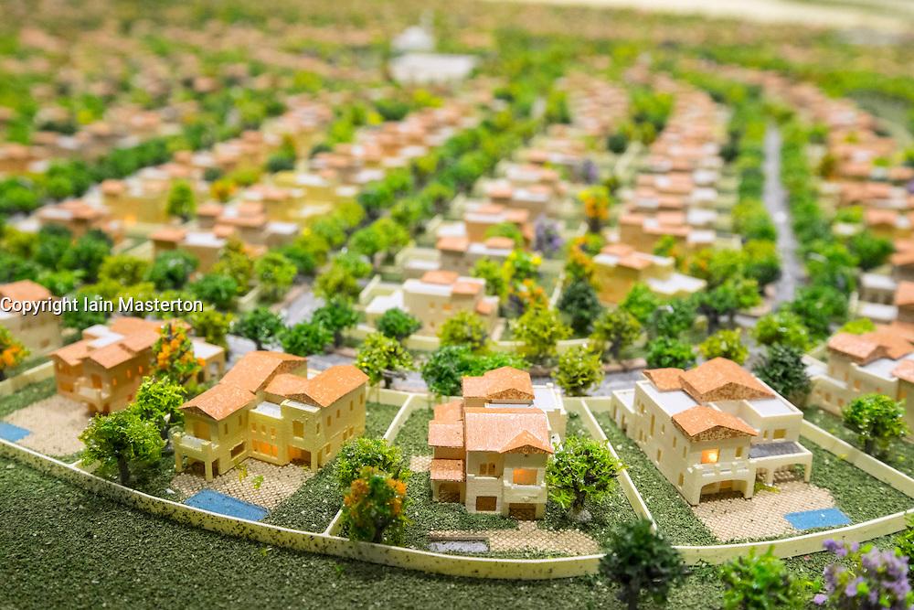 Model of new luxury villas at Dubai Hills Estate by developer Emaar at property trade fair in Dubai United Arab Emirates