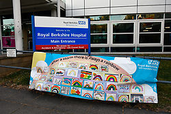 """""""After a storm there is always a rainbow"""" message of hope banner during Coronavirus lockdown, Royal Berkshire Hospital UK May 2020"""