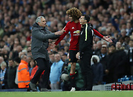Jose Mourinho manager of Manchester United  and Marouane Fellaini of Manchester United after he is sent of by referee Martin Atkinson during the English Premier League match at The Etihad Stadium, Manchester. Picture date: April 27th, 2016. Photo credit should read: Lynne Cameron/Sportimage
