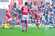 Cauley Woodrow of Barnsley (9) scores a goal and celebrates to make the score 2-1 during the EFL Sky Bet League 1 match between Barnsley and Coventry City at Oakwell, Barnsley, England on 30 March 2019.