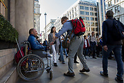 A disabled man begging on Piccadilly during the People's Vote March For The Future on 20th October 2018 in London, United Kingdom. More than 100,000 people marched on Parliament to demand their democratic voice to be heard in a landmark demonstration billed as the most important protest of a generation. As the date of the UK's Brexit from the European Union, the protesters gathered in their tens of thousands to make political leaders take notice and to give the British public a vote on the final Brexit deal.