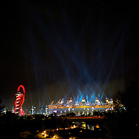 Spotlights light up the sky at the conclusion of a fireworks show in the 2012 London Summer Olympics Opening Ceremony.