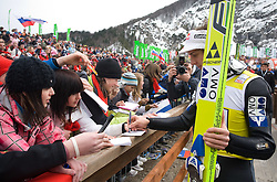 Gregor Schlierenzauer (AUT) with fans at Qualification's 1st day of 32nd World Cup Competition of FIS World Cup Ski Jumping Final in Planica, Slovenia, on March 19, 2009. (Photo by Vid Ponikvar / Sportida)