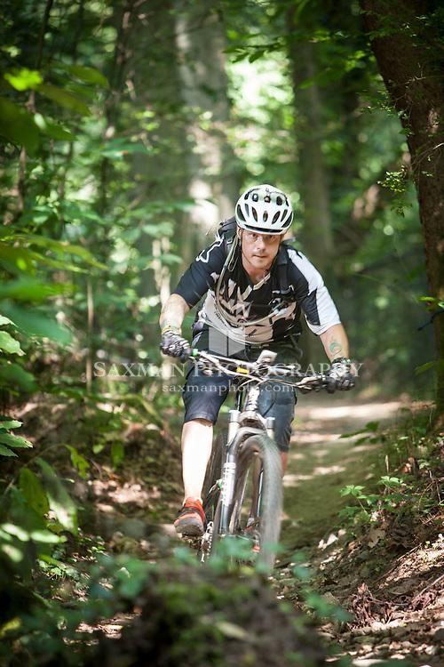 Photos of Dion Miller trail biking on Richmond's Buttermilk Trail