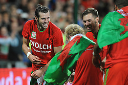 Gareth Bale of Wales celebrates with team mates as Wales qualify for Euro 2016 - Mandatory byline: Dougie Allward/JMP - 07966 386802 - 13/10/2015 - FOOTBALL - Cardiff City Stadium - Cardiff, Wales - Wales v Andorra - European Qualifier 2016 - Group B