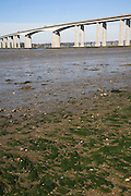 Orwell bridge from east bank looking west over low tide mud flats, Ipswich, Suffolk, England