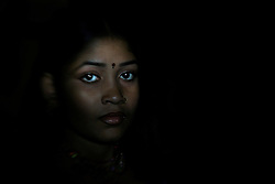 """Sex worker Toma, 14, is seen at brothel, July 4, 2007 in Faridpur, Bangladesh. She was the most beautiful girl in her village and family was afraid that she was going to be gang raped by village boys. """"All the boys in the village wanted her for free. Instead of giving her out for free, we decided to take her to brothel so that she can make money out of it."""" says her sister, who is also a sex worker. She took Toma to brothel about a year ago.<br /> The majority of the 20,000 to 30,000 female sex workers in Bangladesh are victims of trafficking. <br /> Once they enter the brothel, usually before the age of 12, they are generally in for life because of social stigma and poverty."""