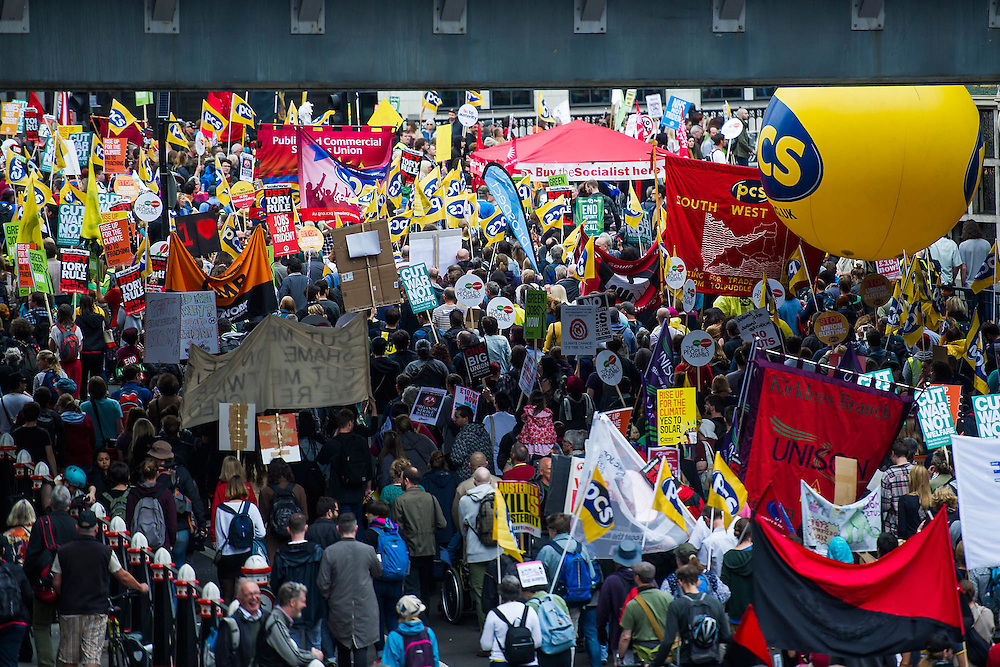 An anti austerity march draws a huge crowd starting at Bank and heading to a rally in Parliament Square. It passed off peacefully and was organised by The Peoples Assembly and supported by all the major unions, including the PCS. 20 June 2015.