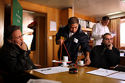 ITF inspector Antonios Maounis meets with officials on board the Alfa K, a Mediterranean based ship with a Panamanian flag in Piraeus, Greece on Feb. 20, 2008. The The inspectors impose ITF-standard treaties on ship-owners to guarantee minimal standard working conditions for seafarers. They are on call 24 hours a day to address concerns from workers coming to port on the international ships.