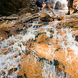 Hikers at Arethusa Falls in Crawford Notch State Park in New Hampshire's White Mountains.