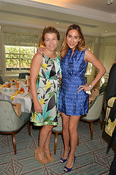 Left to right, AMBER NUTTALL and ALEXANDRA MEYERS at a breakfast hosted by Halcyon Days at Fortnum & Mason, 181 Piccadilly, London on 8th July 2014.