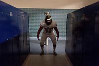 Inderkum Tigers Julian Hernandez (71), gets ready inside the locker room before the game as the Elk Grove thundering Herd varsity football team host the Inderkum Tigers,  Friday Aug 25, 2017.<br /> photo by Brian Baer