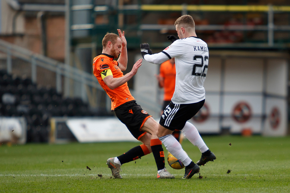 DUNDEE, SCOTLAND, MARCH 20, 2020:  Dundee Utd V Aberdeen FC Ladbrokes SPFL Premiership fixture at Tannadice Park, Dundee.<br /> <br /> Pictured: Mark Reynolds (Dundee Utd Defender) and Florian Kamberi (Aberdeen FC Forward on loan from Swiss Super League side, St Gallen)<br /> <br /> <br /> (Photo: Newsline Media)