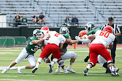 19 September 2015:  Luke Roth gets to Caleb Frye during an NCAA division 3 football game between the Simpson College Storm and the Illinois Wesleyan Titans in Tucci Stadium on Wilder Field, Bloomington IL