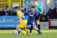 Jake Reeves midfielder for AFC Wimbledon (8) and Scott Brown midfielder Accrington Stanley (18) tussle during the Sky Bet League 2 Play-Off first leg match between AFC Wimbledon and Accrington Stanley at the Cherry Red Records Stadium, Kingston, England on 14 May 2016. Photo by Stuart Butcher.