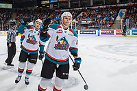 KELOWNA, CANADA - NOVEMBER 11: Gordie Ballhorn #4 and Carsen Twarynski #18 of the Kelowna Rockets skate to the bench to fist bump teammates in celebration of a goal against the Red Deer Rebels  on November 11, 2017 at Prospera Place in Kelowna, British Columbia, Canada.  (Photo by Marissa Baecker/Shoot the Breeze)  *** Local Caption ***