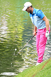 June 25, 2017 - Cromwell, Connecticut, U.S - Wesley Bryan retrieves his ball on the 17th hole during the final round of the Travelers Championship at TPC River Highlands in Cromwell, Connecticut. (Credit Image: © Brian Ciancio via ZUMA Wire)