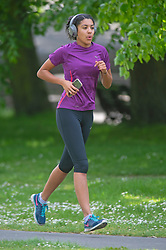©Licensed to London News Pictures 12/05/2020<br /> Greenwich, UK. A lady running in the park. People come out of Coronavirus lockdown to enjoy the warm weather by relaxing in Greenwich park, Greenwich, London this afternoon. Photo credit: Grant Falvey/LNP