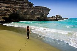 Woman visitor at Green Sand Beach, Mahana Bay, South Point, Big Island, Hawaii, Pacific Ocean