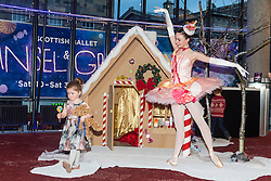 Scottish Ballet dancer Grace Paulley joins local children in front of a festive gingerbread house ahead of the opening night of Hansel and Gretel.<br /> <br /> Pictured: Niamh Kelly (aged 3) with Grace Paulley