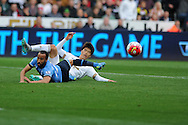 Andros Townsend of Tottenham is tackled by Swansea city's Ki Sung-Yueng as he breaks into the box with the goal in his sight.  Barclays premier league match, Swansea city v Tottenham Hotspur at the Liberty Stadium in Swansea, South Wales on Sunday 4th October 2015.<br /> pic by  Andrew Orchard, Andrew Orchard sports photography.