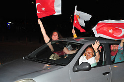 Supporters of Turkey's President and ruling Justice and Development Party, or AKP, leader Recep Tayyip Erdogan celebrate elections victory in Canakale, Sunday, June 24, 2018. Unofficial results from Turkey's presidential election show incumbent Recep Tayyip Erdogan with a commanding lead. Photo by Burak Gezen/DHA/Depo Photos/ABACAPRESS.COM