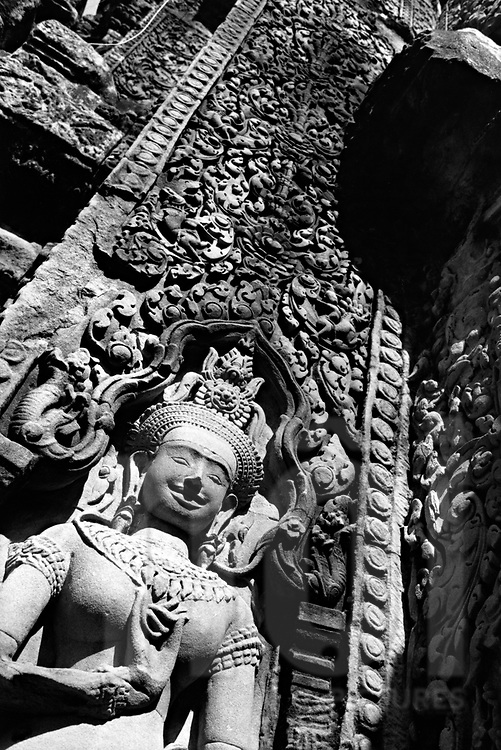 Below view of a goddness' relief on temple wall, Angkor Wat, Cambodia, Asia.