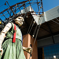 LIVERPOOL, UK, 20th April, 2012. The Sea Odyssey. The little girl giant walks past Anfield football stadium.