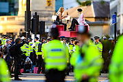 Extinction Rebellion activists continue to sit on a pink structure that was erected during the group's 'Impossible Rebellion' series of actions at Oxford Circus in central London, on Wednesday, August 25, 2021. - Climate change demonstrators from environmental activist group Extinction Rebellion continued with their latest round of protests in central London, promising two weeks of disruption. (VX Photo/ Vudi Xhymshiti)