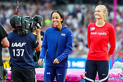 London, August 12 2017 . Katarina Johnson-Thompson, Great Britain, smiles for the TV camera as she is introduced before the women's high jump final as Michaela Hrubá, Czech Republic, awaits her turn on day nine of the IAAF London 2017 world Championships at the London Stadium. © Paul Davey.