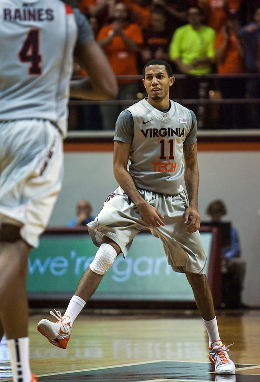 Nov 27, 2012; Blacksburg, VA, USA; Virginia Tech Hokies guard Erick Green (11) reacts after making a basket during second half against the Iowa Hawkeyes at Cassell Coliseum. Mandatory Credit: Peter Casey-USA TODAY Sports