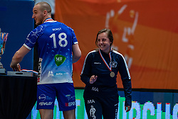Dennis Borst of Lycurgus, Malou Alferink celebrate after the cup final between Amysoft Lycurgus vs. Draisma Dynamo on April 18, 2021 in sports hall Alfa College in Groningen