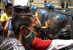 June 12, 2017 - Philippines - Filipino protesters scuffle with police as they attempt to march to the US Embassy during a rally coinciding with the 119th Philippine Independence Day in Manila, Philippines on Monday, June 12, 2017. (Credit Image: © Richard James Mendoza/Pacific Press via ZUMA Wire)