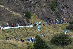 All Under One Banner Independence March, Edinburgh, Saturday 6th October 2018<br /> <br /> Pictured: Flags were being flown from Salisbury Crags<br /> <br /> Alex Todd | Edinburgh Elite media