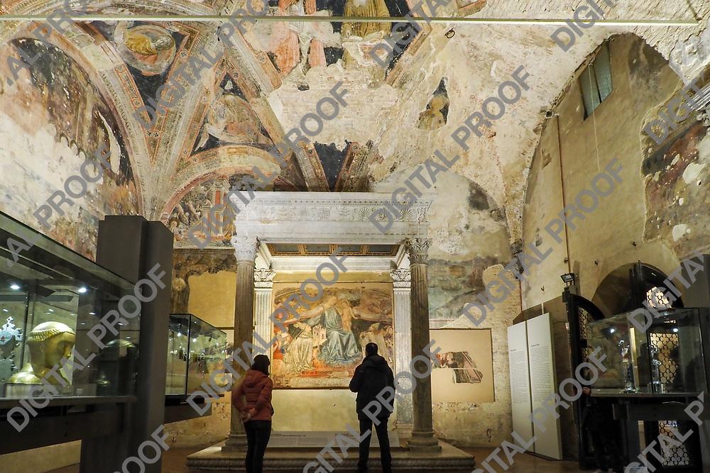 Tourists visit the Old Sacristy of Santa Maria della Scala in Siena Italy