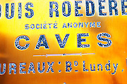A polished brass sign at the winery of Louis Roederer saying cave (the wine cellar), Reims, Champagne, Marne, Ardennes, France