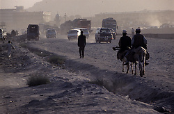 Travelers in a gravel path of Kabul