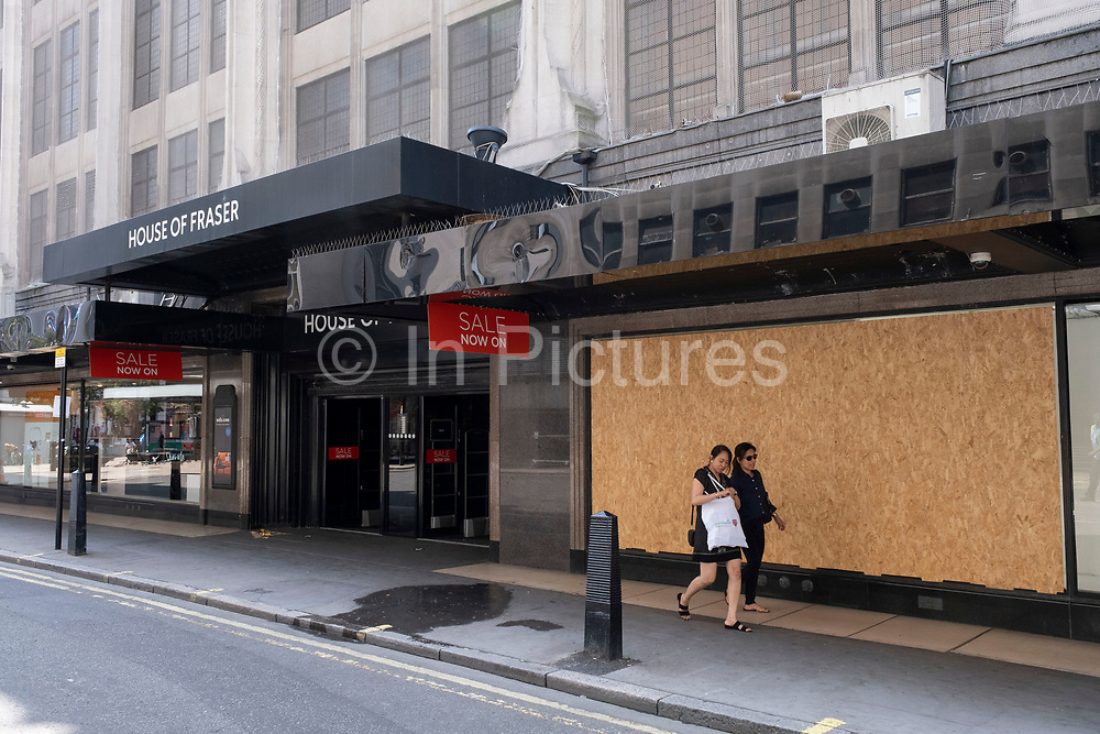 As some non-essential shops re-open, shoppers return to Oxford Street while social distancing measures are put in place by the various retail shops which are open on 26th June 2020 in London, England, United Kingdom. As the July deadline approaces and government will relax its lockdown rules further, the West End remains quiet, apart from this popular shopping district, which itself has far fewer people on its pavements than normal.