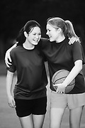 Image of two teenage girls playing basketball, model released by Randy Wells