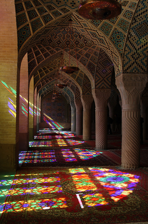Sunlight streams through the stained-glass windows of the winter prayer hall in the Nasir-ol-Molk Mosque, Shiraz, Iran.