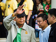 09 JANUARY 2016 - BANGKOK, THAILAND:        PRAYUTH CHAN-O-CHA, the Prime Minister of Thailand, waves while he walks through crowd at Government House during Children's Day festivities at Government House. National Children's Day falls on the second Saturday of the year. Thai government agencies sponsor child friendly events and the military usually opens army bases to children, who come to play on tanks and artillery pieces. This year Thai Prime Minister General Prayuth Chan-ocha, hosted several events at Government House, the Prime Minister's office.       PHOTO BY JACK KURTZ