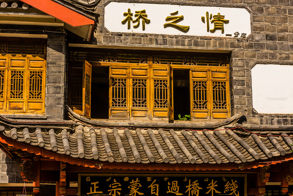 Wooden buildings in the Old Town (Dayan) of Lijiang, Yunnan Province, China. The Old Town is a UNESCO World Heritage Site.