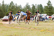 """09 SEPTEMBER 2007 -- ST. MICHAELS, AZ: The start of a two and a half mile race at a traditional Navajo Horse Race in the summit area of the Navajo Indian reservation about 10 miles west of St. Michaels, AZ. Traditional horse racing is making a comeback on the Navajo reservation. The races are run on improvised courses that vary depending on the local terrain. Use of saddles is optional (except in the """"Cowhand Race"""" which requires a western style saddle) and many jockeys ride bareback. The distances vary from one mile to as long as thirty miles. Traditional horse races were common until the 1950's when they fell out of favor, but there has been a resurgence in traditional racing since the late 1990's and now there is a traditional horse racing circuit on the reservation. The race was organized by the Begay family of Steamboat, AZ and run on private land about three miles from a paved road.  Photo by Jack Kurtz"""